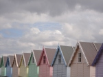 Pretty pastel coloured beach huts at Mersea
