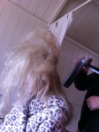 Hair spraying the back combed hair