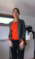 Casual smart orange blouse and grey suit jacket