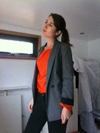 Smart grey suit jacket and bright orange silk blouse